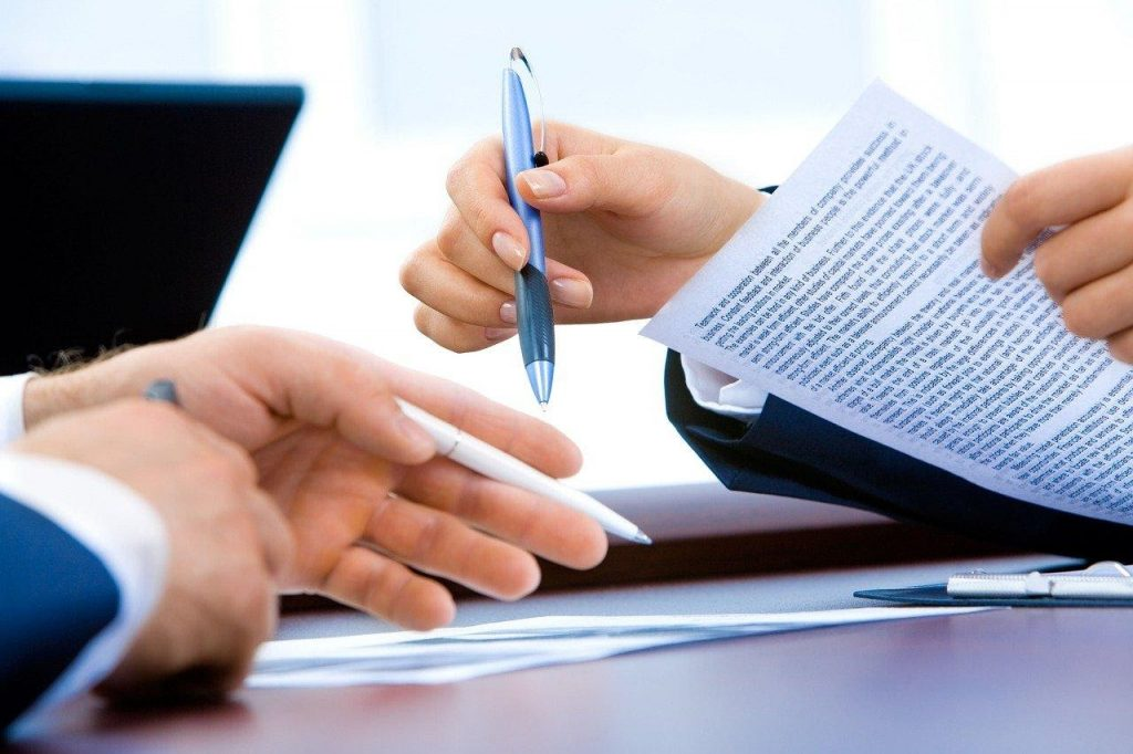 Hands in Business Meeting